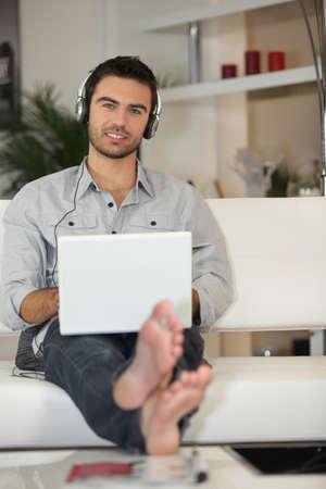live stream listening: Man using headphones