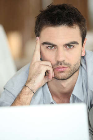 young unshaven: Relaxed man using laptop Stock Photo