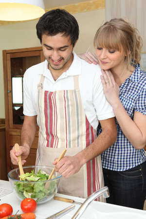 Couple making a salad Stock Photo - 12903285