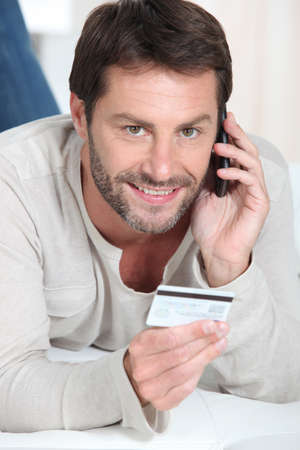 Man shopping over the telephone photo