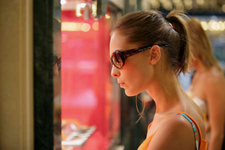 Attractive woman window shopping photo