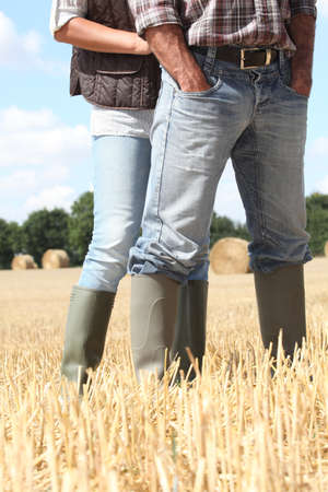 Farming couple in field photo