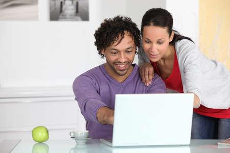 online shopping: couple having fun on Internet Stock Photo