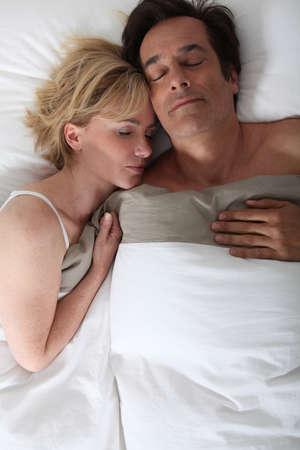 45 55 years: Husband and wife sleeping Stock Photo
