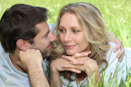 Loving couple embracing in a meadow Stock Photo - 12597024