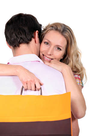 portrait of couple with bag photo