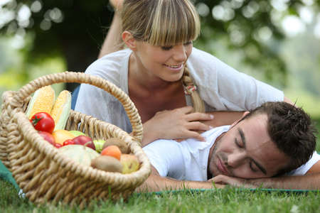 Couple with a basket of produce
