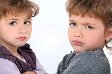 sibling rivalry: Sulky children Stock Photo