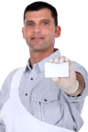Painter with blank business card Stock Photo - 12595034