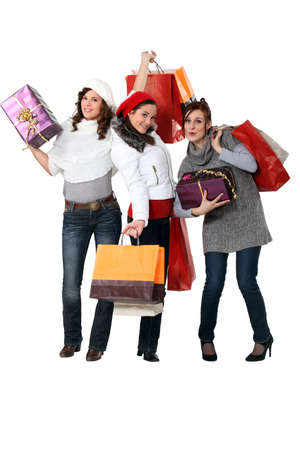 Women carrying bags and gifts photo