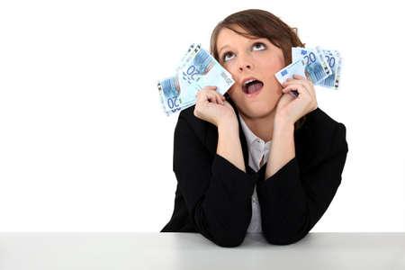 cloud nine: Woman crazy about money