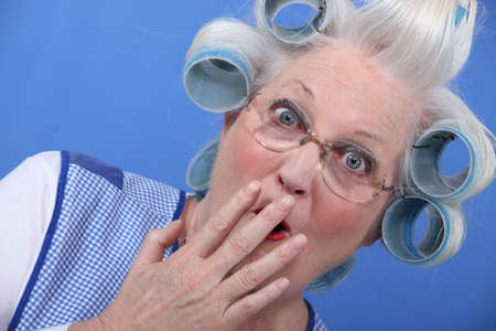 Shocked grandma with hair rollers photo