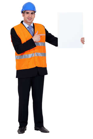 Man stood with blank poster photo