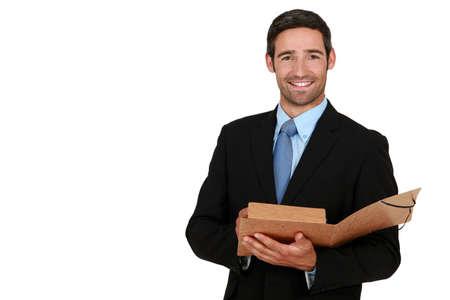 pile of paper: Happy businessman holding folder Stock Photo