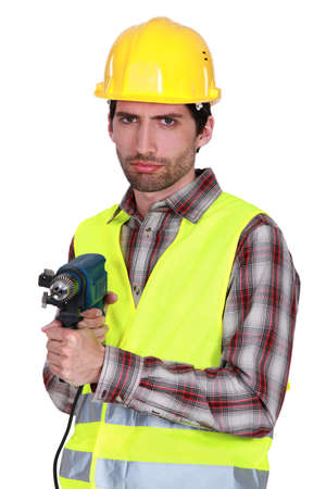 Portrait of a frowning tradesman Stock Photo - 12636882