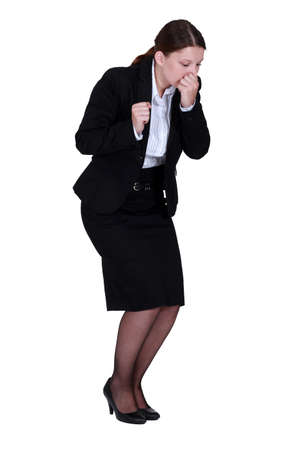 Businesswoman sneezing photo