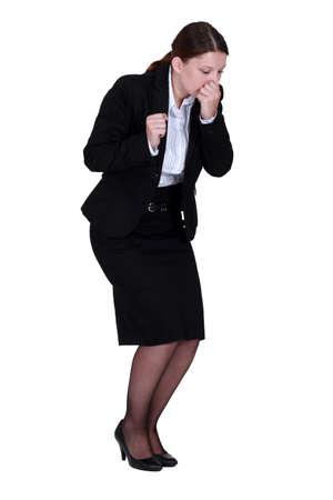 Businesswoman sneezing photo