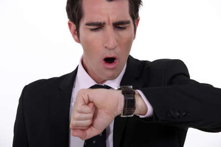 businessman in a hurry looking at his watch photo