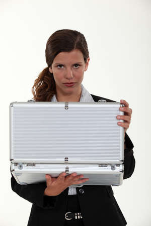 Woman opening metal briefcase Stock Photo - 12599751