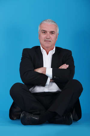 Middle-aged businessman sat cross-legged Stock Photo - 12599819