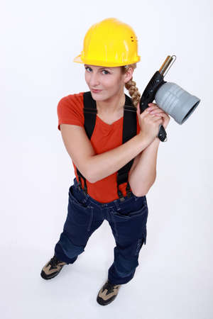 Tradeswoman holding a blowtorch photo