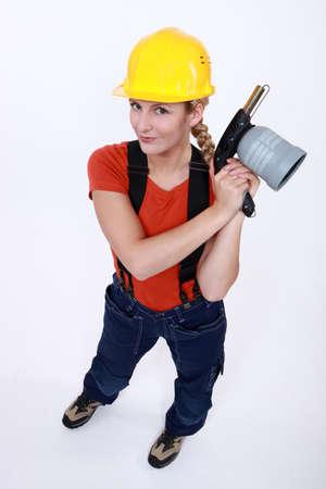 blowtorch: Tradeswoman holding a blowtorch Stock Photo