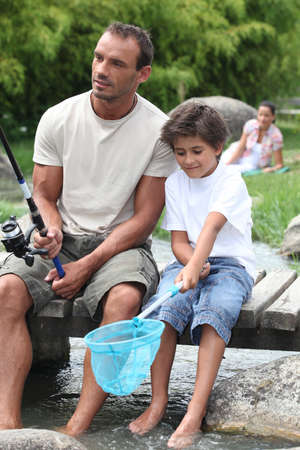 Man out fishing with his son Stock Photo - 12903129