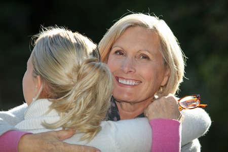 Women hugging Stock Photo - 12637327