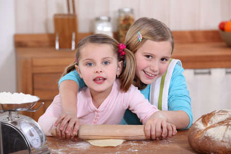 Sisters baking in the kitchen Stock Photo