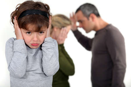 offend: couple having a quarrel in front of their little girl Stock Photo