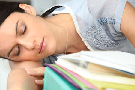 sit down: Woman asleep on her workplace Stock Photo