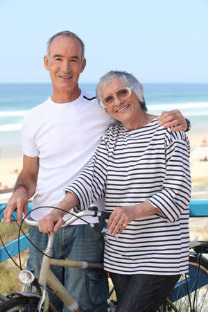 shoulder ride: senior man and senior woman at the beach