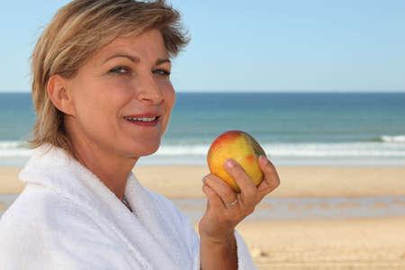 Mature woman in bathrobe photo