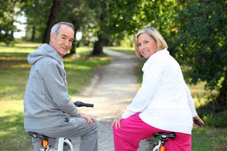 sweats: A couple of cyclists Stock Photo