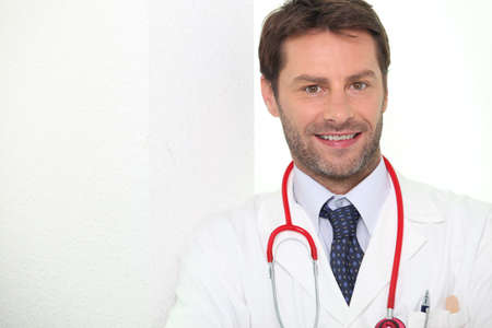 Male doctor stood smiling Stock Photo - 12637958