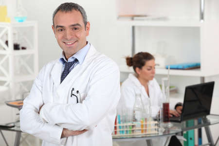 cross armed: smiling doctor cross-armed in lab Stock Photo