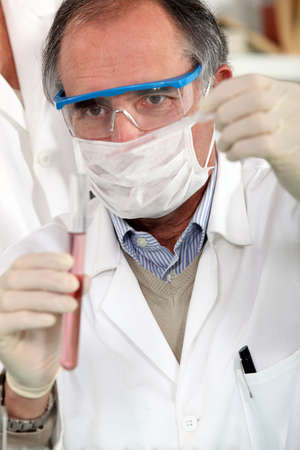 doctor analysing test-tube Stock Photo - 12597176