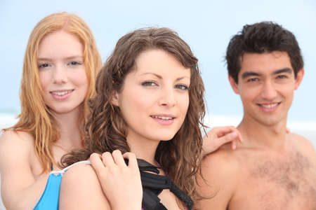 Young friends at the beach photo