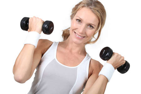 50 55: Woman lifting weights Stock Photo
