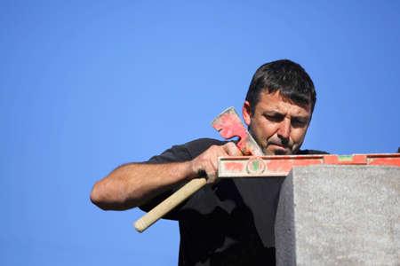 Tradesman using an axe and a bubble level Stock Photo - 12594644