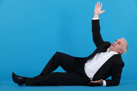 one senior man only: A mature businessman lying on the floor  Stock Photo