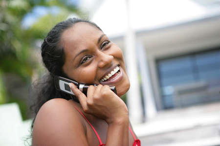African American woman laughing during call photo
