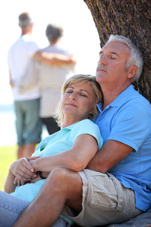 50 55: Mature couple dozing in the sunshine