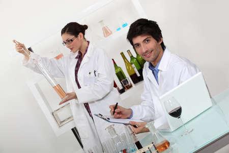 oenology: female and male wine laboratory technicians