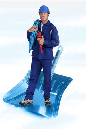 Plumber stood on giant shovel Stock Photo - 12761777