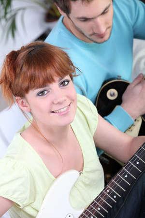 Teenagers playing guitar photo
