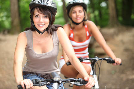 portrait of 2 girls on bikes photo