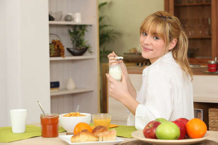 weight reduction plan: young woman having breakfast Stock Photo