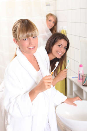 dorm: Young women in the bathroom together