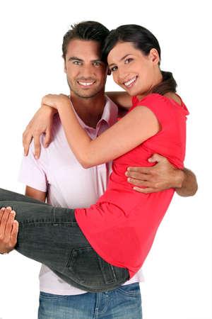 carrying girlfriend: Man carrying girlfriend